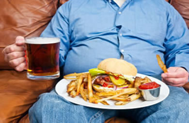 overweight man eating Overcoming Overeating