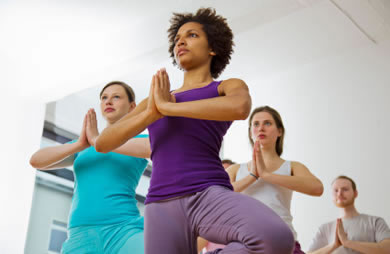 Women doing yoga tree pose
