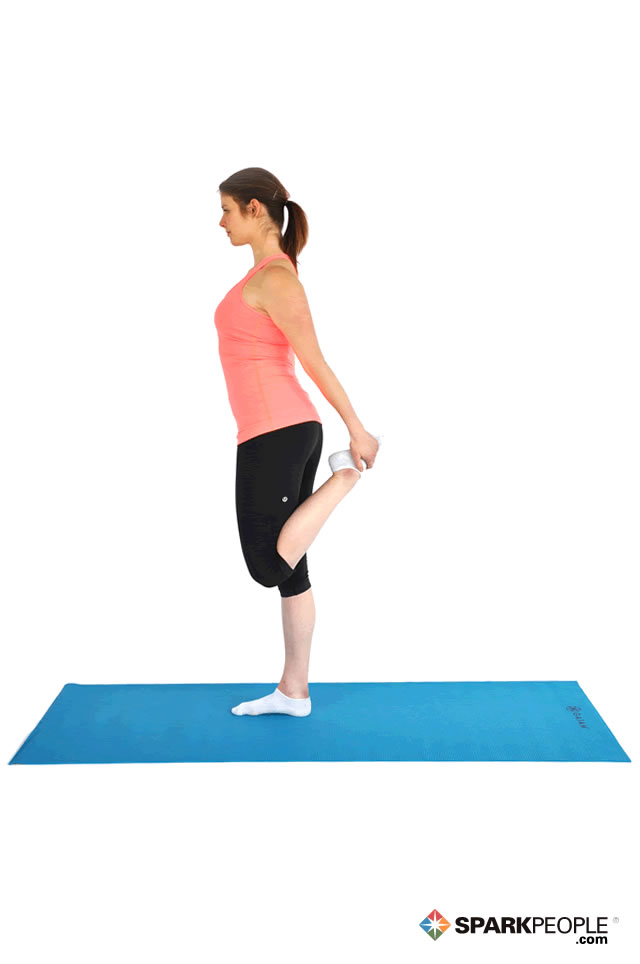 Standing quad stretch exercise demonstration sparkpeople for Floor yoga stretches